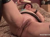 Mature BBW fucks herself with large dildo