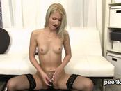 Striking girl is pissing and finger fucking shaven vagina